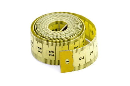 cm: Yellow measuring tape coiled, isolated over white Stock Photo