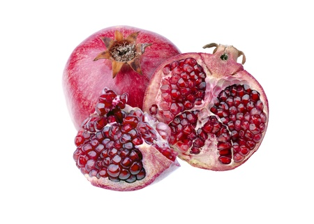 Composition, consisting of whole and sliced pomegranate, isolated over white Stock Photo - 17101860