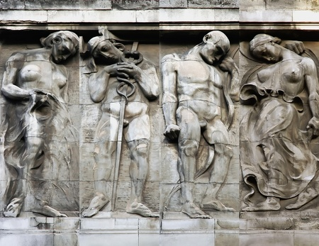 Bas-relief mens and womens in the old building in Lvov, Ukraine Stock Photo - 17146680