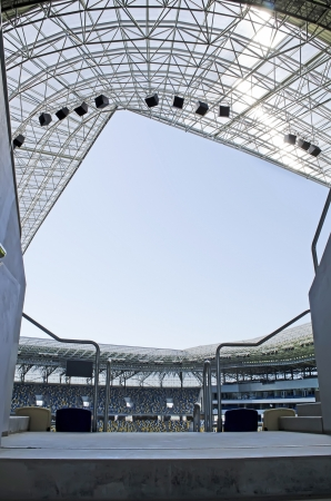 Sign in empty stadium. View of the empty stands and the stadium roof Stock Photo