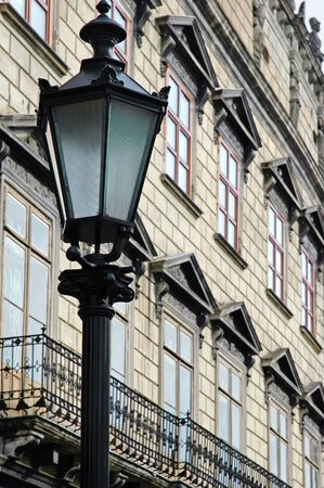 Cityscape - Street light on the background of the old building in Lvov, Ukraine photo