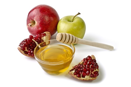 Apples, pomegranate and bowl of honey over white. Illustration of Rosh Hashanah (jewish new year) or Savior of the Apple Feast Day Stock Photo