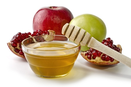 Apples, pomegranate and bowl of honey over white. Illustration of Rosh Hashanah (jewish new year) or Savior of the Apple Feast Day Stockfoto