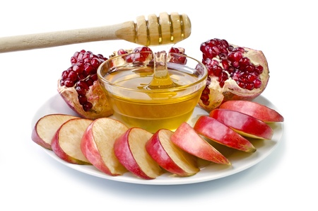 Cut into slices of apples, pomegranate and bowl of honey over white. Illustration of Rosh Hashanah (jewish new year) or Savior of the Apple Feast Day