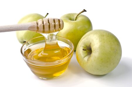 feast day: Green apples and a bowl of honey over white. Illustration of Rosh Hashanah (jewish new year) or Savior of the Apple Feast Day