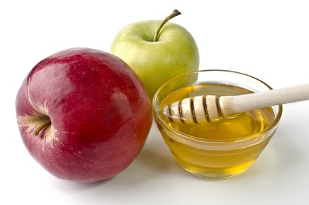 Red and green apples and a bowl of honey over white. Illustration of Rosh Hashanah (jewish new year) or Savior of the Apple Feast Day Stock Photo
