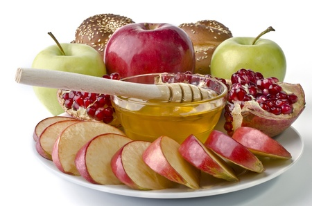 Still life - challah, apples, pomegranate and bowl of honey over white. Illustration of Rosh Hashanah (jewish new year) or Savior of the Apple Feast Day