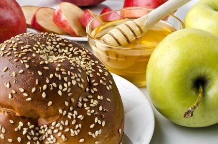 jewish cuisine: Still life closeup - challah, apples and bowl of honey closeup. Illustration of Rosh Hashanah (jewish new year) or Savior of the Apple Feast Day
