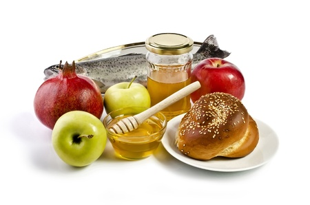Still life with apples, pomegranates, fish, challah and honey over white. Illustration of Rosh Hashanah (jewish new year) or Savior of the Apple Feast Day