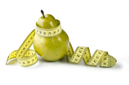 Pear and measuring tape, isolated over white photo