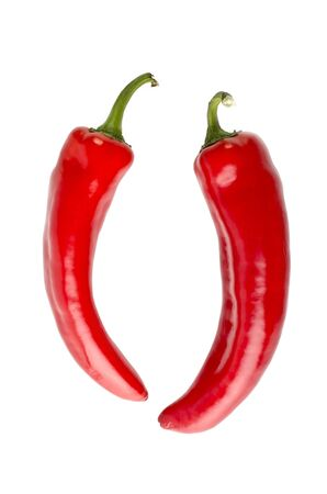 Two red peppers, isolated on a white background photo