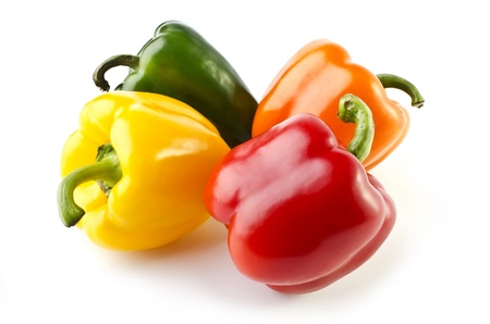 Four colorful peppers close-up, isolated on a white background