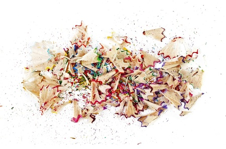 sharpenings: Shavings of colored pencils closeup isolated on a white background