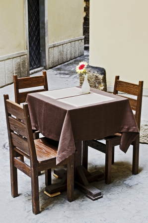 Lone table and chairs in a restaurant outdoors
