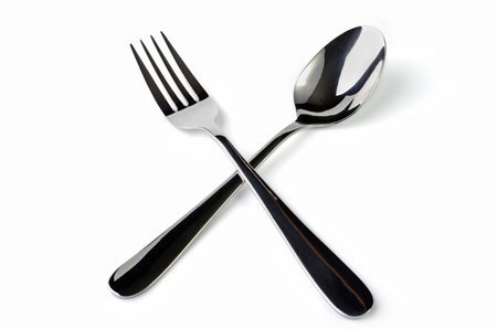Cutlery  crossed fork and knife close-up, isolated on a white background photo