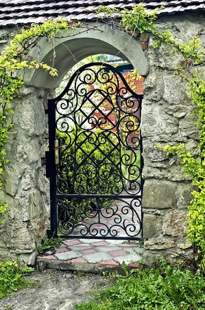 Wrought iron gate in a stone fence photo