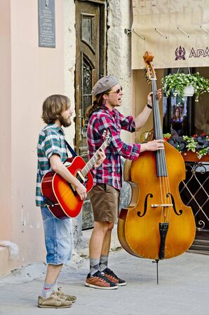 busker: LVOV, UKRAINE - MAY 12: Street musicians in the center of Lvov entertain tourists on May 12, 2013 in Lviv, Ukraine
