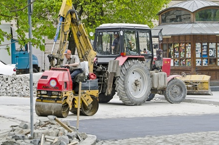 compacted: LVOV, UKRAINE - APRIL 27: Road roller compacted asphalt during the repair on the main street of Lvov on April 27, 2013 in Lviv, Ukraine Editorial