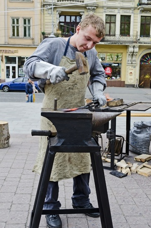LVOV, UKRAINE - APRIL 28: Blacksmith a master class on the main street in celebrate the Day of the City on April 28, 2013 in Lviv, Ukraine