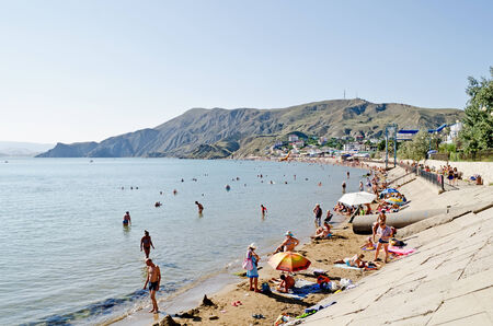 forbade: ORDZHONIKIDZE, UKRAINE - AUGUST 19: The cabinet of the Crimea forbade to take a payment for using of public beaches on August 19, 2013 in Ordzhonikidze, Ukraine.