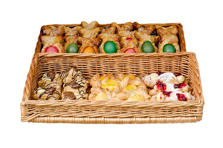 bake sale: Bake in a basket for Easter, isolated over white Stock Photo