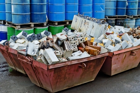 Pile of old batteries and steel drums for recycling Stock Photo
