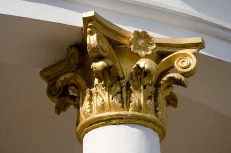 architectural  detail: Architectural detail - Gold capital in Greek style