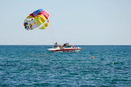 sudak: SUDAK, CRIMEA, RUSSIA - AUGUST 24: Attraction - the parachute on the water in Sudak on august 24, 2014 in Sudak, Crimea, Russia