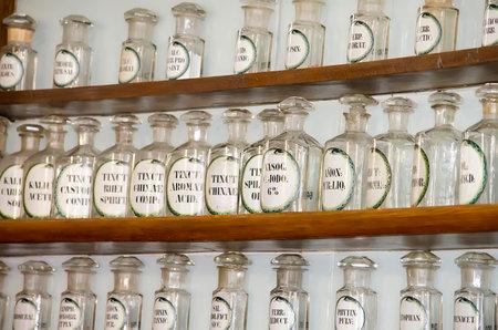phial: LVOV, UKRAINE - APRIL 29: Empty retro medical drug bottles in an old pharmacy-museum on April 29, 2012 in Lvov, Ukraine