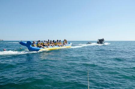 sudak: SUDAK, CRIMEA, RUSSIA - AUGUST 24: Start of the attraction - riding on water banana in Sudak on august 24, 2014 in Sudak, Crimea, Russia
