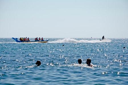 sudak: SUDAK, CRIMEA, RUSSIA - AUGUST 24: Attraction on the water - riding on water banana in Sudak on august 24, 2014 in Sudak, Crimea, Russia