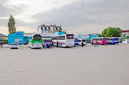 bus station: FEODOSIA, CRIMEA, RUSSIA - JUNE 08: Buses and people are waiting for the departure from the central bus station on June 08, 2014 in Feodosia, Crimea, Russia