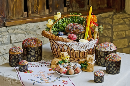 lvov: LVOV, UKRAINE - APRIL 30: Easter still life - Easter eggs, Easter cakes, basket, chickens, sausage, candle in the restaurant Puzata Hata in the center of Lvov on April 30, 2013 in Lvov, Ukraine