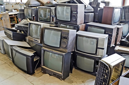 Pile of non-working old TVs close-up Stock Photo