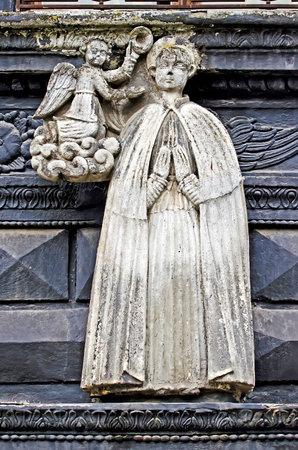 lvov: LVOV, UKRAINE - JULY 11: The sculpture of St. Florian on the building of the Black Kamenica on July 11, 2012 in Lvov, Ukraine