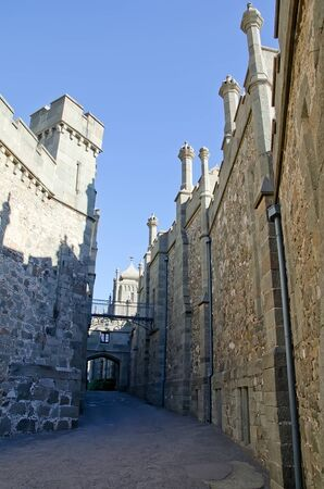 vorontsov: Architectural landmark - Old street in the Vorontsov Palace in Alupka, Yalta, Crimea. Medieval towers and walls