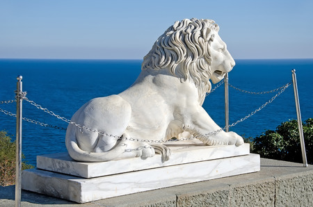 alupka: Architectural landmark - Sculpture of a lion of white marble in the Vorontsov Palace in Alupka, Yalta, Crimea Editorial