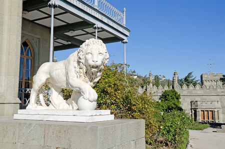 Architectural landmark - Sculpture of a lion of white marble with ball in the Vorontsov Palace in Alupka, Yalta, Crimea