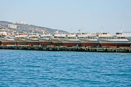 pleasure ship: Pleasure boats in the sea port in Yalta, Crimea Stock Photo