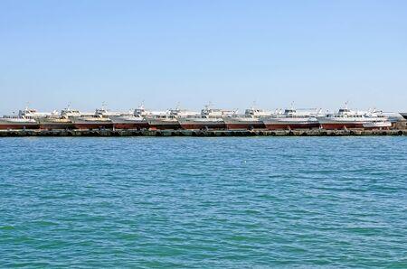 pleasure ship: Pleasure boats on the pier in the sea port in Yalta, Crimea