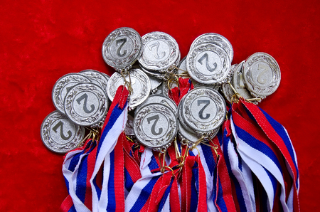 silver medal: Many silver medal with tricolor ribbons close-up.