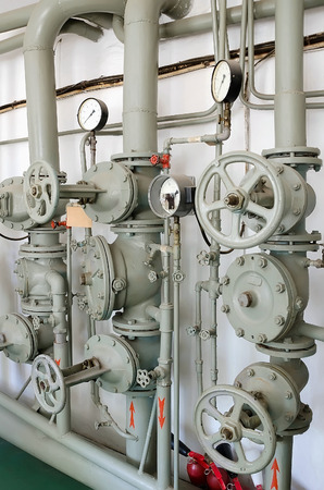 fire extinguishing: Industrial background - Iron pipes for water supply or fire-extinguishing valves, and gauges. Fire extinguishing system