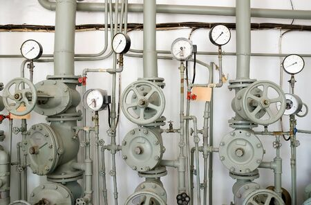 extinguishing: Industrial background - Iron pipes for water supply or fire-extinguishing valves, and gauges. Fire extinguishing system
