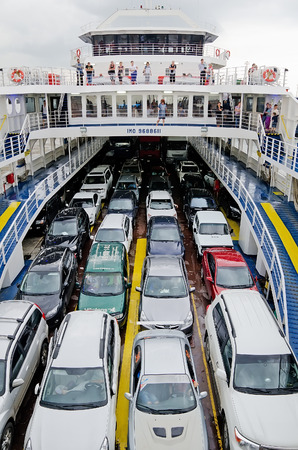 kavkaz: KERCH, CRIMEA, RUSSIA - JUNE 26: Cars and passengers on the ferry in the port of Crimea on June 26, 2015 in Kerch, Crimea, Russia Editorial