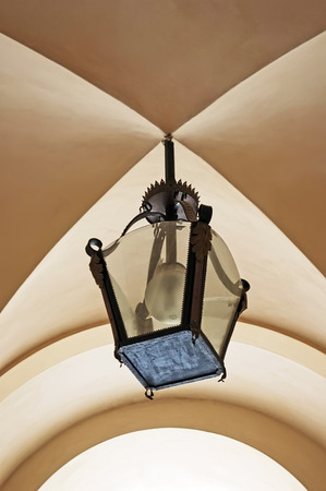 lvov: Street lamp under the arches closeup in lvov Stock Photo