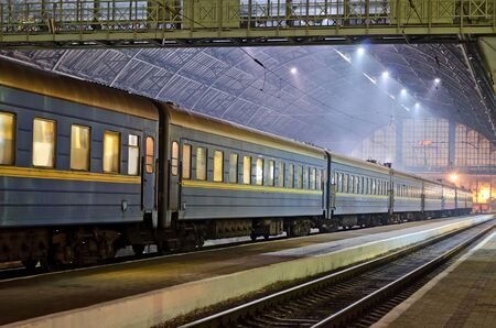 lvov: Passenger train at the railway station in Lvov at night