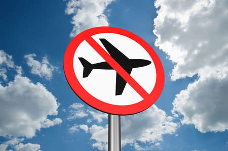 vapor trail: Sign to ban flights of airplanes on sky background Stock Photo