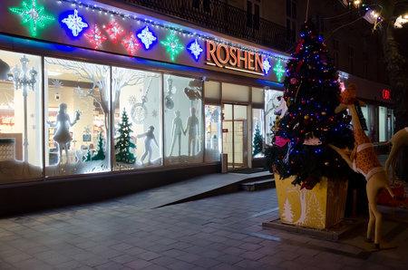 lvov: LVIV, UKRAINE - DECEMBER 22: Christmas shop window Roshen in the center of Lviv on December 22, 2016 in Lvov, Ukraine Editorial