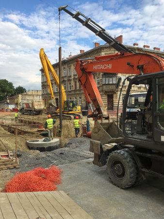 LVIV, UKRAINE - JULY 05: Construction machinery during the major overhaul of the road in Lychakivska Street in Lviv on July 05, 2017 in Lvov, Ukraine