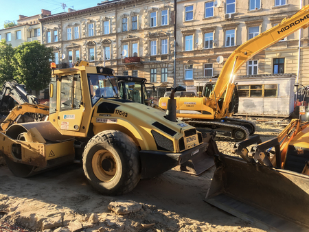 LVIV, UKRAINE - MAY 17: Construction machinery during the major overhaul of the road in Lychakivska Street in Lviv on May 17, 2017 in Lvov, Ukraine